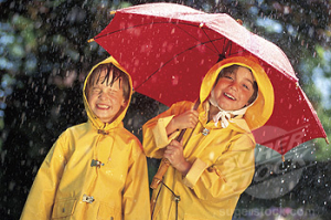 Children with umbrella in the rain, portrait.